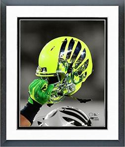 Oregon Ducks Football Helmet Spotlight Photo  Framed